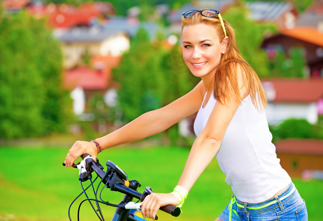 Happy woman on bicycle