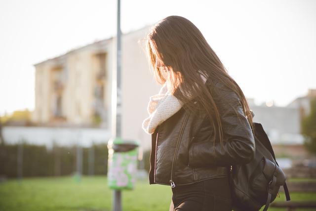 young beautiful long hair woman in town