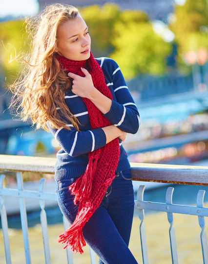 Beautiful girl in red scarf on a fall day in Paris