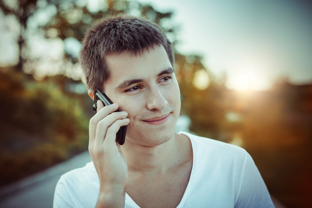 Man talking by the mobile phone outdoors