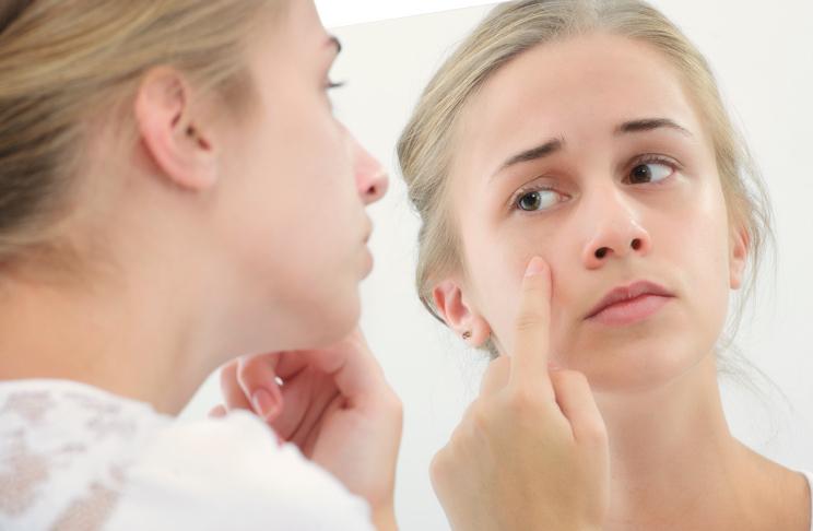 Teenage girl with the mirror