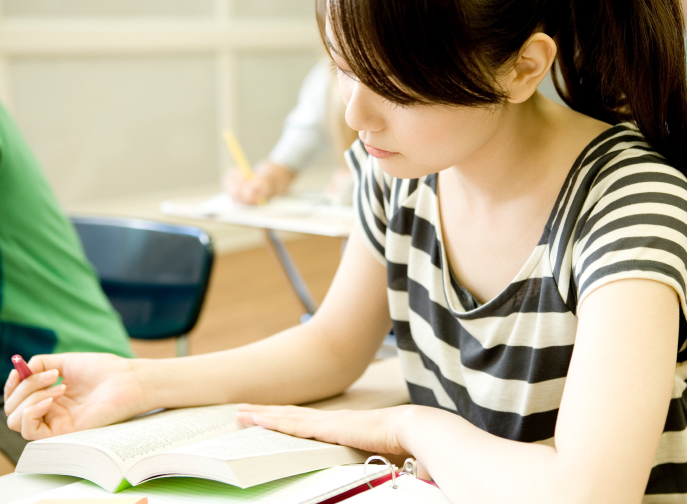 Female student studying in classroom