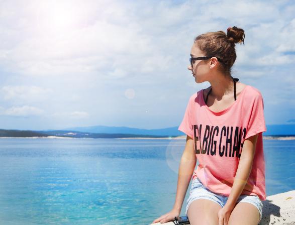 Teenage girl looking at the sea