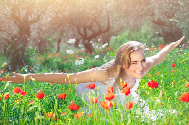Girl having fun on poppy field