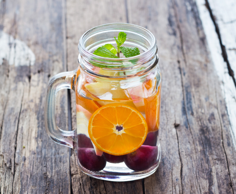 Mug delicious refreshing drink of mix fruits with mint, infusion