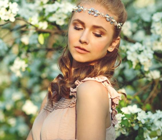 Beautiful girl in spring garden