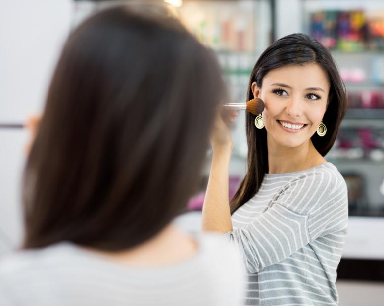 Latin American woman putting some make up