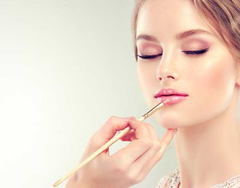 Young beautiful woman.Make-up in progress.